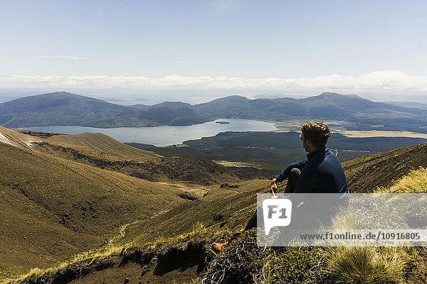 New Zealand  Tongariro National Park  hiker looking to Mangatepopo Valley