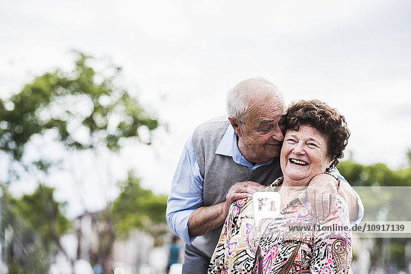 Portrait of happy senior woman with her husband