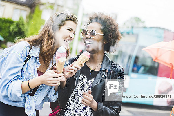 Two laughing women with icecream cones