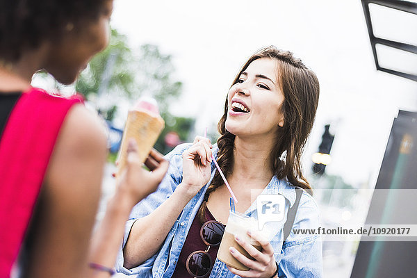 Portrait of young woman talking to her best friend
