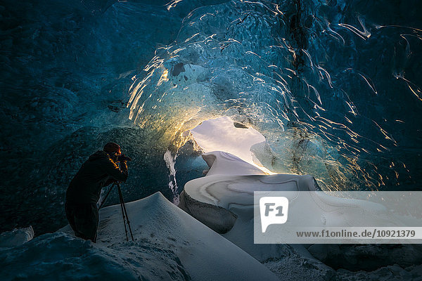 Photographer in ice cave  Iceland