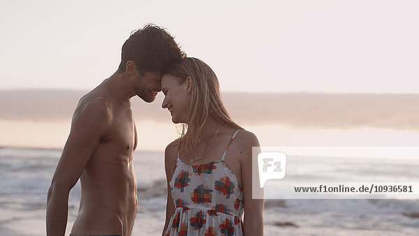 Affectionate young couple on beach