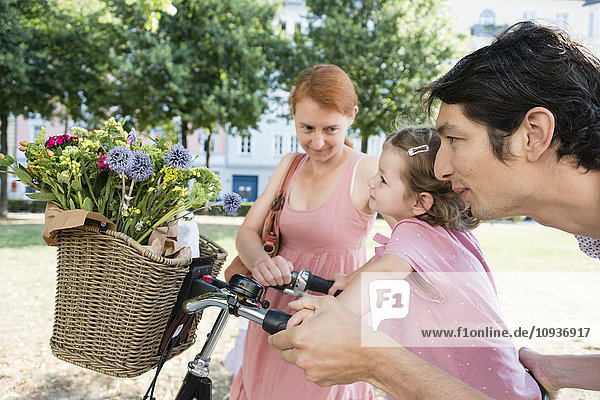 Family with two children and bicycle
