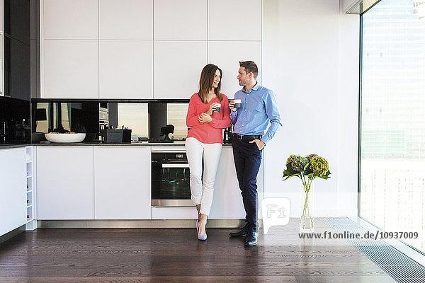 Couple in apartment having a coffee break