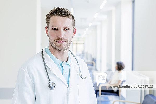 Portrait of doctor in hospital corridor