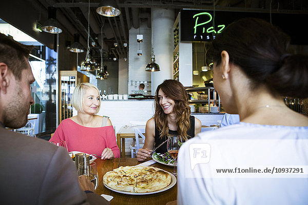 Group of friends celebrating in restaurant