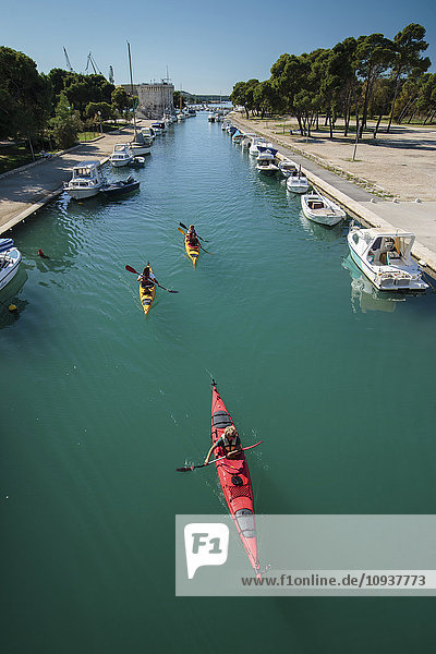 Group of people kayaking in canal