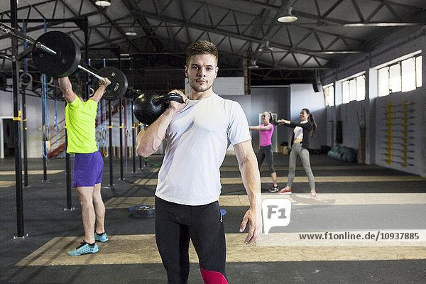 Men doing strength training in gym