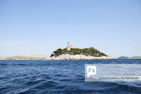 Lighthouse on island in Adriatic Sea