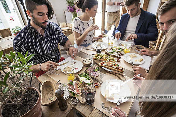 Group of friends having lunch in restaurant
