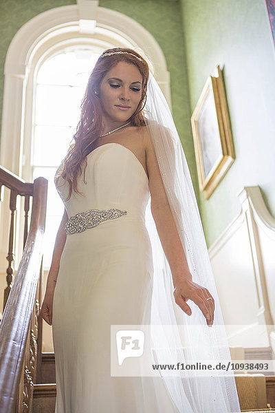 Bride showing off wedding dress