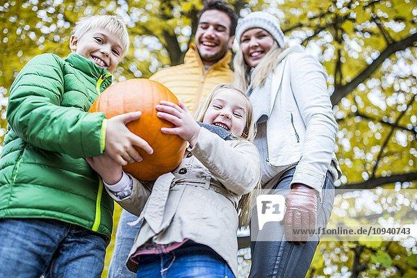 Children holding pumpkin
