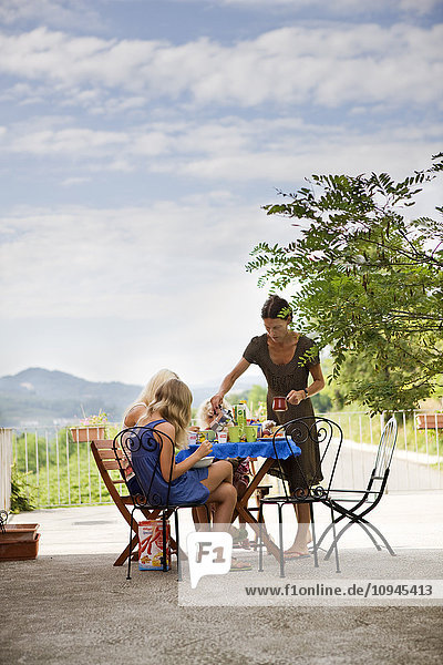 Italy  family having outdoor lunch