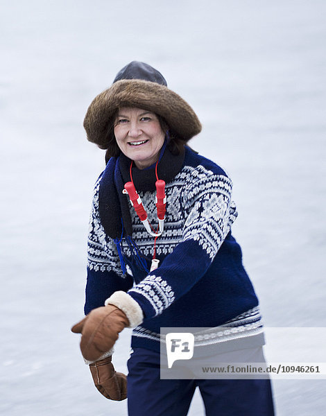 Portrait of woman ice skating