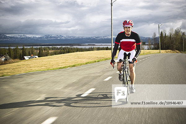 Man riding cycle on road
