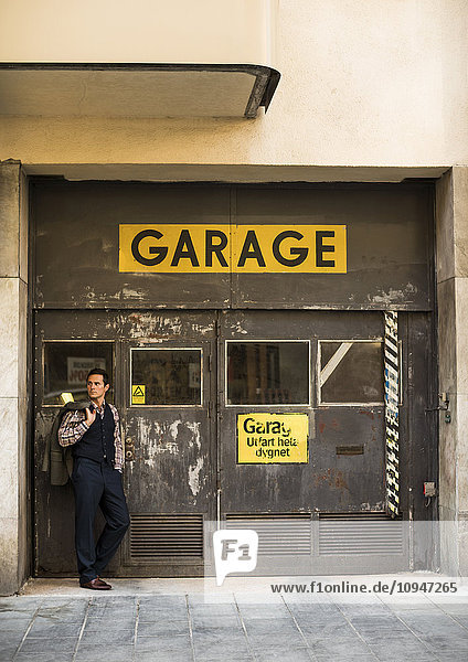 Elegant man in front of garage