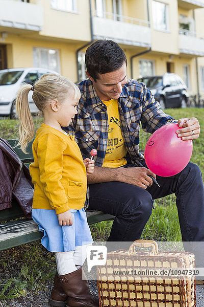 Father with daughter on bench