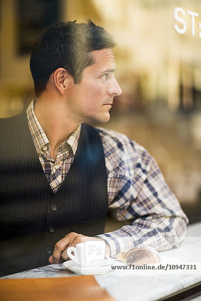 Elegant man in cafe
