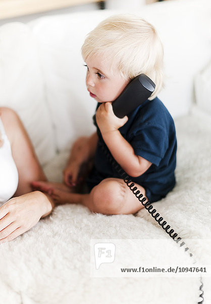 Baby talking on phone