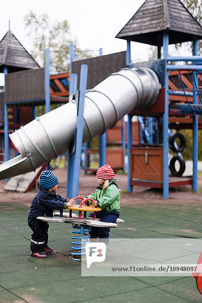 Children playing at jungle gym
