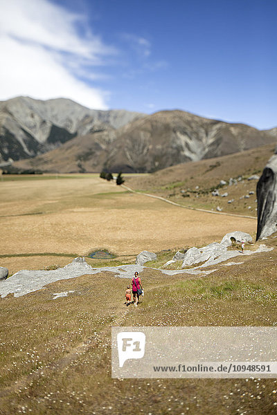 Mother with child walking in mountains