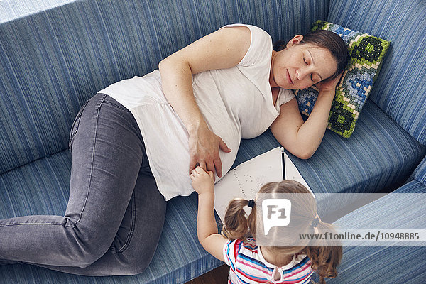 Mother with daughter on sofa