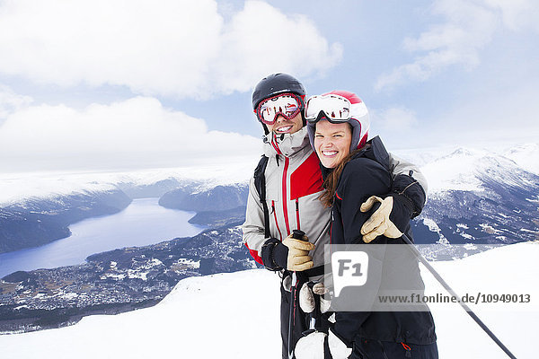 Portrait of smiling couple skiing