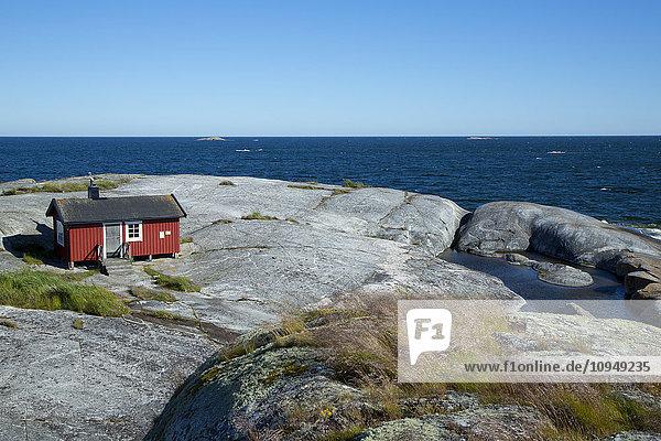 Wooden house on rocky coast