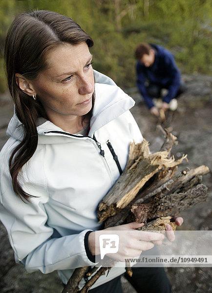 Woman holding firewood