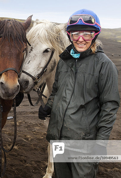 Portrait of woman with Icelandic horses