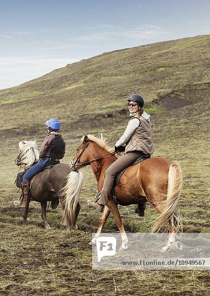 Women riding Icelandic horses