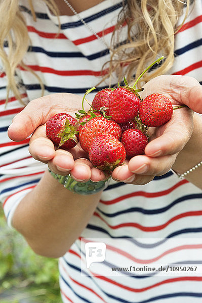 Girls hands with strawberries