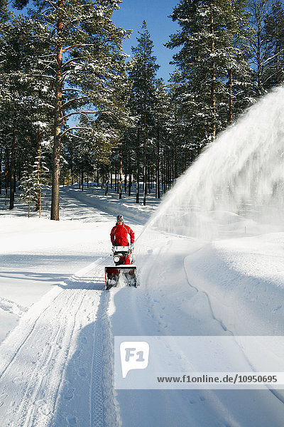 Person pulling snowplow