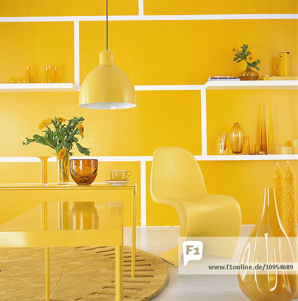 Decorated room with yellow furniture and wall.