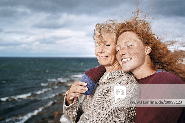 Mother and adult daughter together at sea