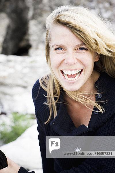 A Scandinavian woman laughing,  Sweden.