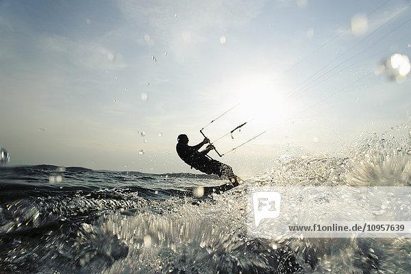 One person kite-surfing  Sweden.