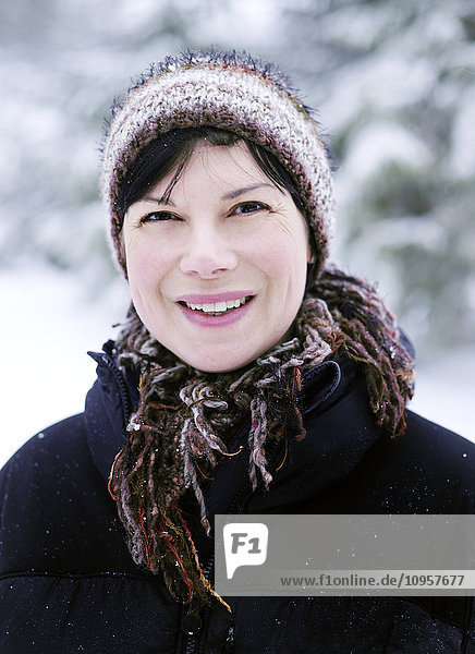 Woman in a snowy forest  Norway.