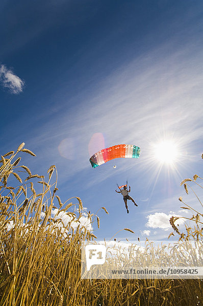 Parachute jumper in the sky  Sweden.
