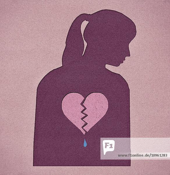 Silhouette einer Frau mit gebrochenem Herz