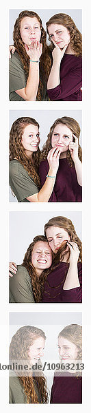 'Two young women creating photo booth series of images in filmstrip format; Alberta  Canada'