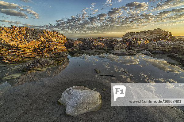 'Late day light on the rocks of Marble Beach in Namakwaland National Park; South Africa'