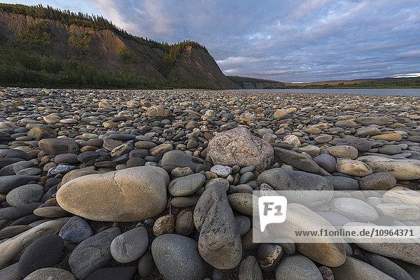 'The rocky shoreline along the Peel River  near Taco Bar; Yukon  Canada'