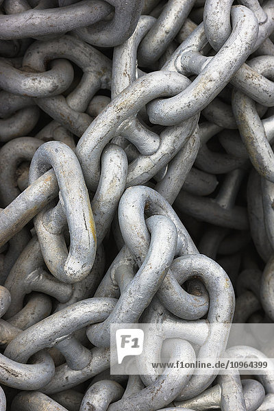 Close up of steel chain links in a pile  St. Paul Harbor  St. Paul Island  Southwestern Alaska  USA  summer