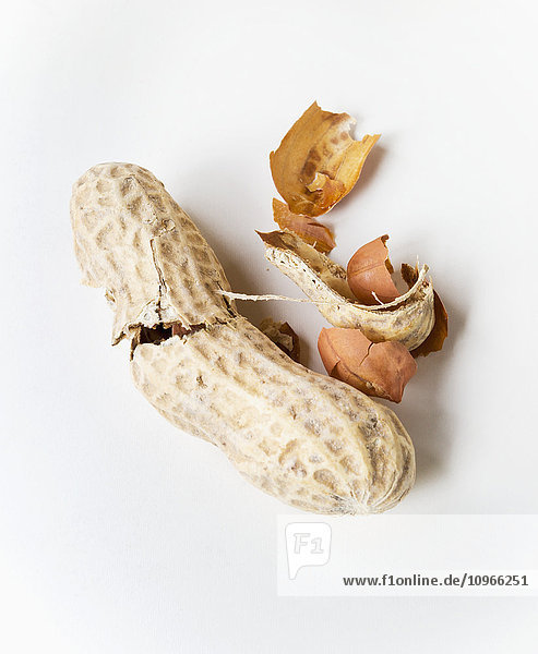 'Peanuts and shell on a white background; Chilliwack  British Columbia  Canada'