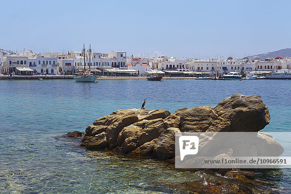 'Boats and whitewash buildings in the bay; Mykonos  Greece'