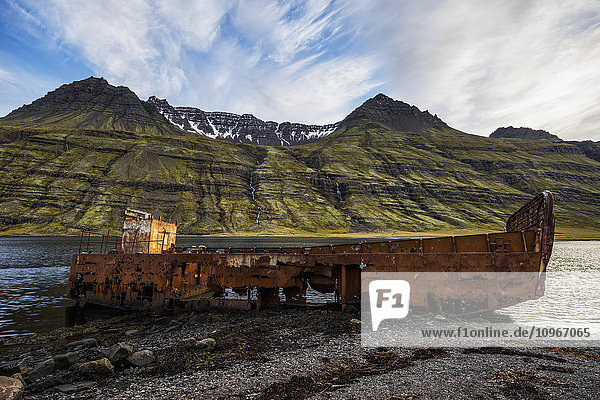 'Old shipwreck along the water in Mjoifjordur  East Iceland; Iceland'
