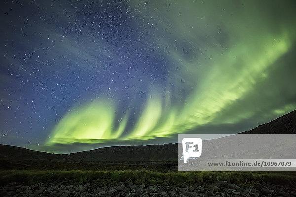 'Northern lights over Dynjandi in the Westfjord region; Iceland'