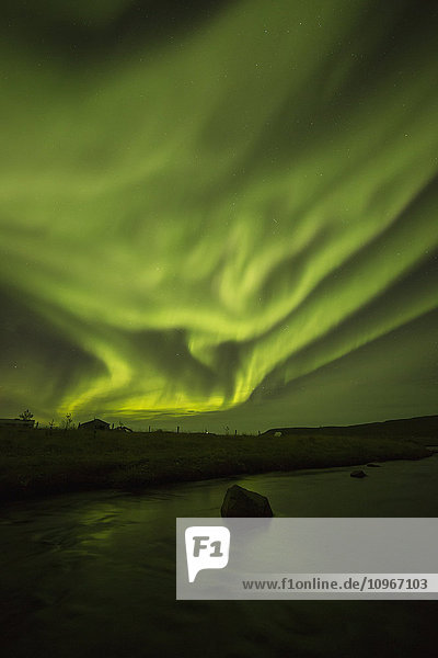 'Northern lights dancing over the Langanes Peninsula and the Atlantic Ocean; Iceland'