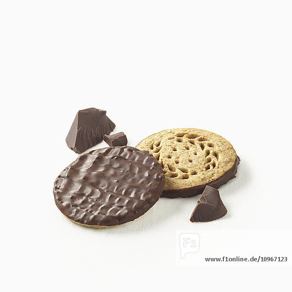 'Chocolate covered cookies with pieces of chocolate on a white background; Toronto  Ontario  Canada'